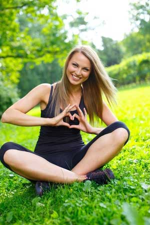 Healthy woman smiling while sitting outside