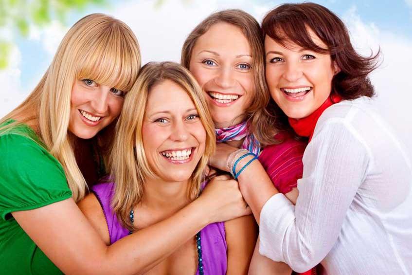 Four smiling women