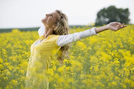 Happy woman in a field of flowers